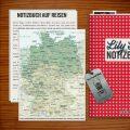 Lily Lux Notizbuch auf Reisen beim Geocaching