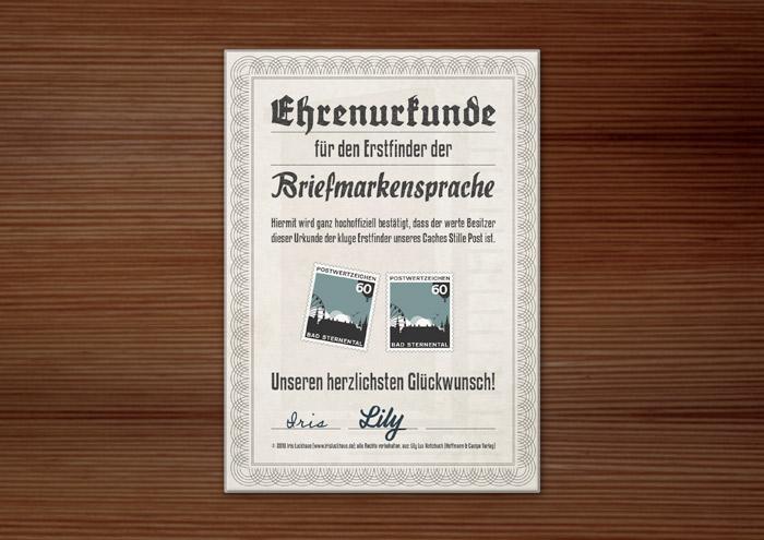 Design der Ehrenurkunde für den Lily Lux Geocache Stille Post mit Briefmarkensprache