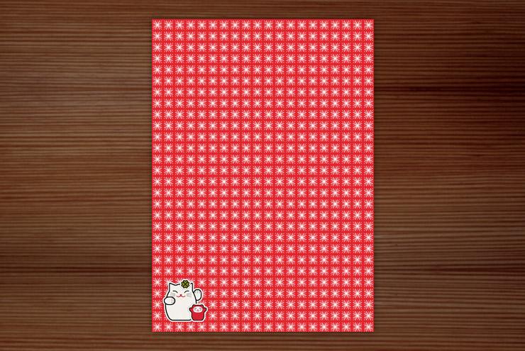Postkarte zur Werbung für das Lily Lux Notizbuch im typischen roten Muster mit weißen Sternen und Winkekatzen Aufklebern